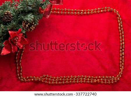 Christmas decoration fir branch on red. - stock photo