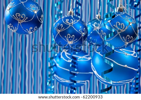 Christmas decoration from blue balls on blue background