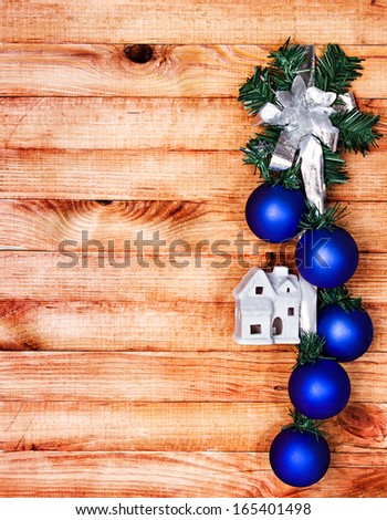 Christmas decoration, garland on wooden background - stock photo