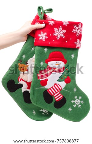 Christmas decoration gift sock in hand isolated on white background