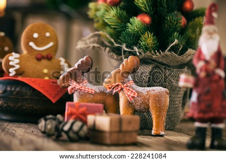 Christmas decoration. Gingerbread cookies. Santa Claus and reindeer with Christmas tree, presents and gingerbread man. - stock photo