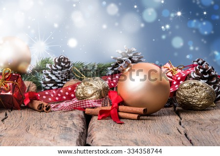 Christmas decoration, gold ball on dark wooden background  - stock photo