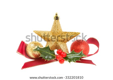 Christmas decoration, gold star,ribbon,baubles and holly isolated against white - stock photo