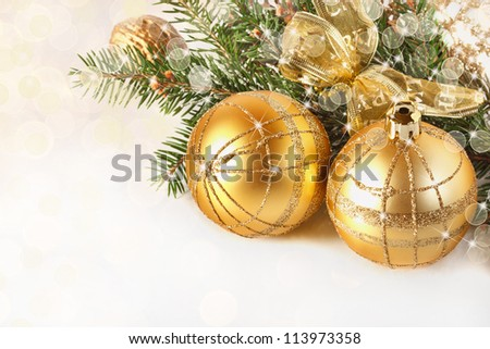 Christmas decoration. Golden Christmas baubles and ribbon close up. - stock photo