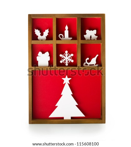 Christmas decoration, hand cut paper craft in a wooden printer tray. - stock photo
