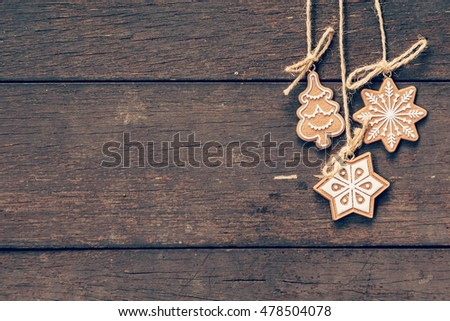 christmas decoration hanging on wood background with copyspace.