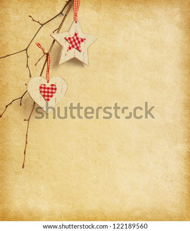 Christmas decoration hanging over old paper background. - stock photo