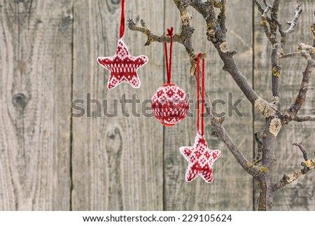 Christmas decoration hanging over old wooden board - stock photo