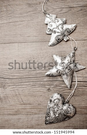 Christmas decoration hanging over the wooden background - stock photo