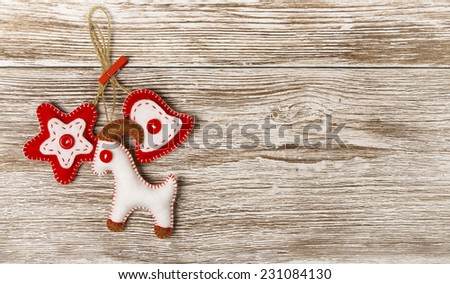 Christmas Decoration Hanging Toy, Grunge Wooden Background, New Year of the Goat, Grain White Wood Wall, Xmas Decorative Texture - stock photo