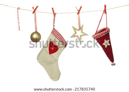 Christmas decoration, hat sphere sock candy cane hanging on washing line, isolated on white background - stock photo
