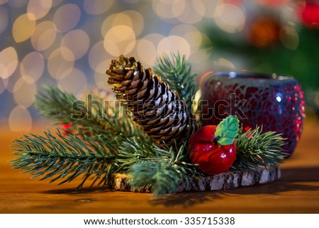 christmas, decoration, holidays and new year concept - close up of natural fir branch decoration and fir-cone and lantern on wooden table - stock photo