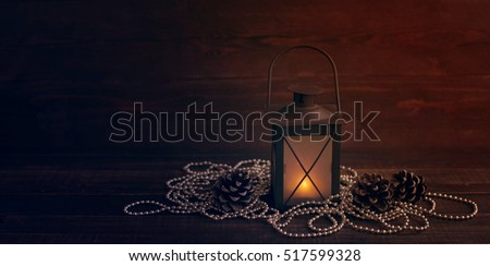 Christmas decoration, holidays, new year and decor concept. Closeup New Year's fir tree toys and candlestick on a wooden background
