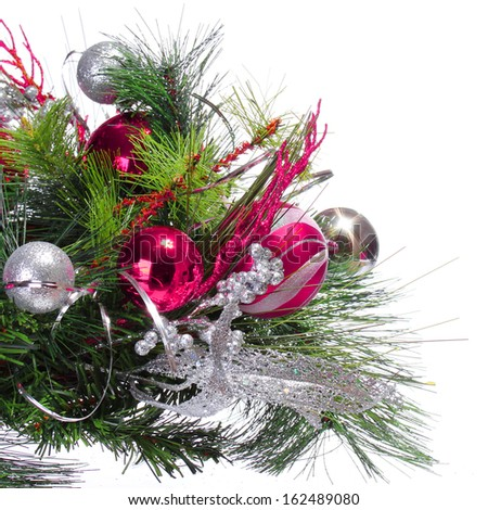 Christmas Decoration. Hot Pink Balls on Christmas tree branch isolated on white background. Holidays - stock photo