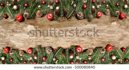 Christmas decoration in border of a old wooden board
