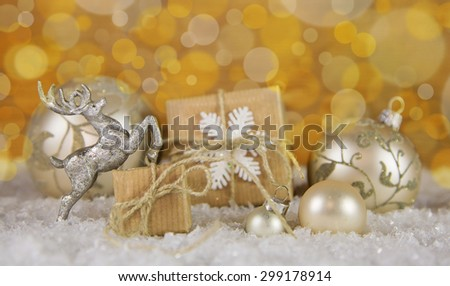 Christmas decoration in gold, silver and white with gift boxes. - stock photo
