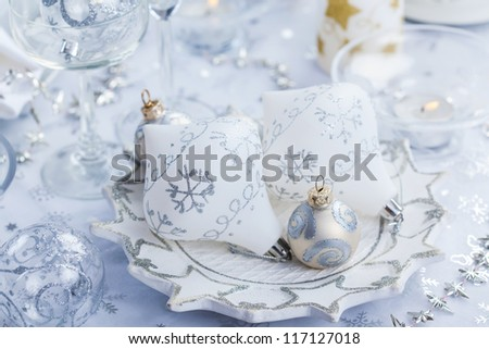 Christmas decoration in silver and white for festive table