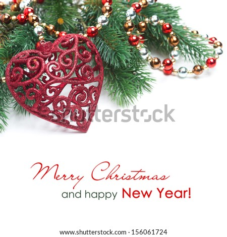 Christmas decoration in the form of heart, spruce branches and garland isolated on white - stock photo