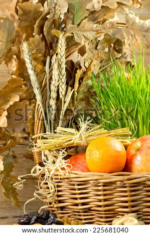 Christmas decoration in wicker basket on table - stock photo