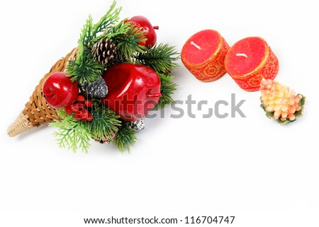 Christmas decoration isolated on white background. The branch ate with decorations and candles.