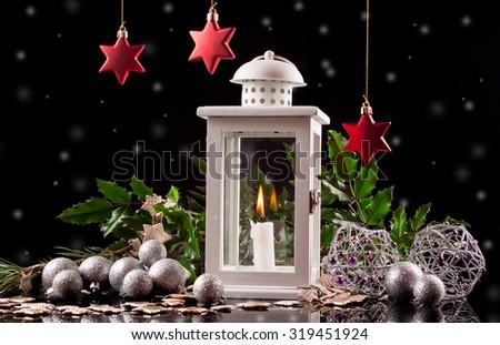 Christmas decoration lantern with burning candle - stock photo