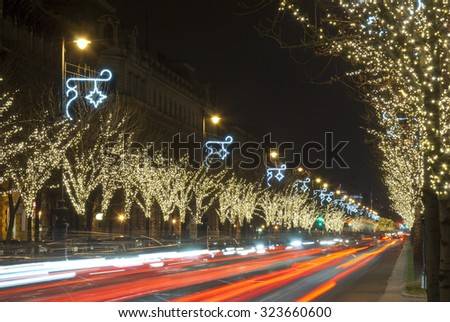christmas decoration light bulb garlands on a row of trees, Andrassy road, Budapest, Hungary - stock photo