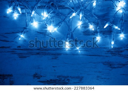 christmas decoration lights garland. festive ornament. blue toned picture - stock photo