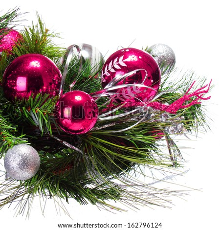 Christmas Decoration. Magenta Balls on Christmas tree branch isolated on white background. Holiday Card - stock photo