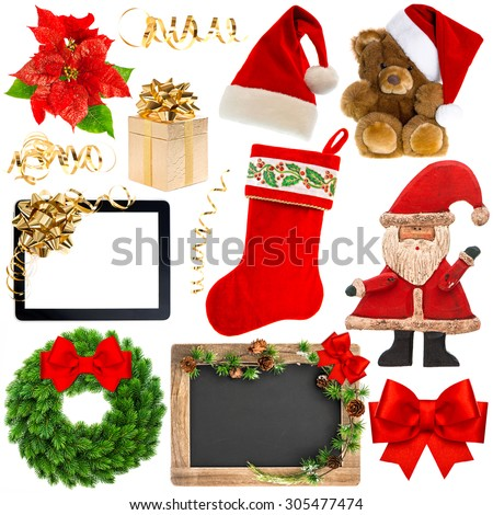 Christmas decoration objects isolated on white background. Santa's hat, red stocking, gift box, tablet pc with red ribbon bow, chalkboard with christmas tree branches - stock photo