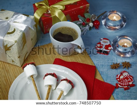 Christmas decoration of breakfast table with coffee cup and handmade marshmallow candies