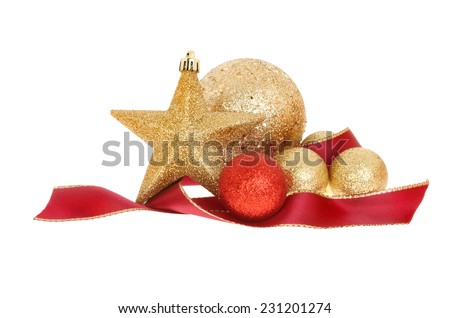 Christmas decoration of gold baubles and star with a red ribbon isolated against white - stock photo