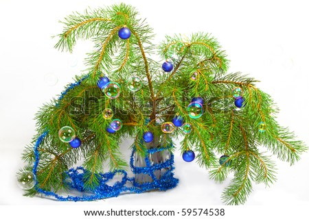 christmas decoration on a fir-tree branches with toys and soap bubbles