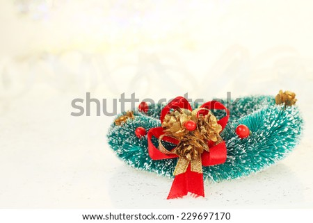 Christmas decoration on abstract glowing bokeh background - stock photo