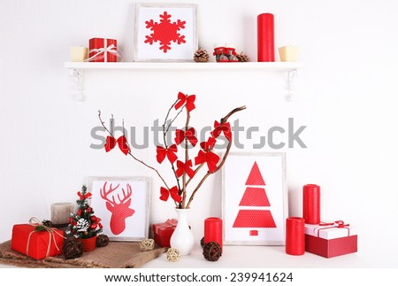 Christmas decoration on burlap cloth on white wall background - stock photo