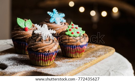 Christmas decoration on cupcakes, beautiful holiday background. Three cupcakes, horizontal