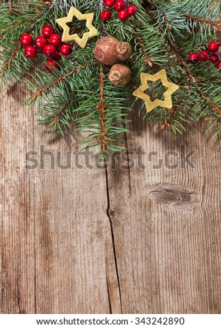 Christmas decoration on old  wooden plank. - stock photo