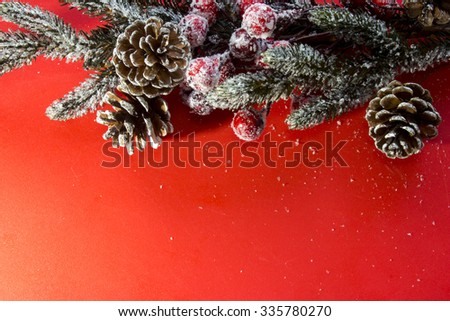 Christmas decoration on red background.