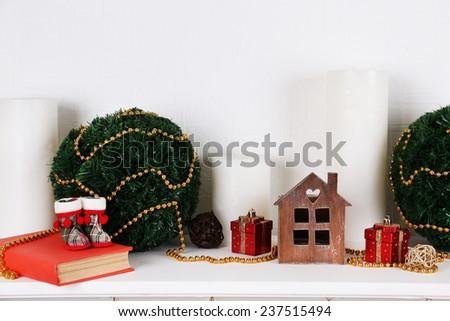 Christmas decoration on shelf on white background - stock photo