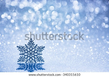 Christmas decoration on snow against blurred lights background - stock photo