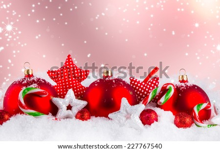 Christmas decoration on snow, Red ball with abstract background - stock photo