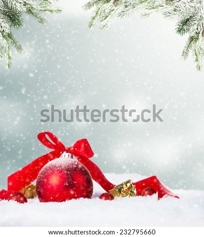 Christmas decoration on snow with blur abstract background - stock photo
