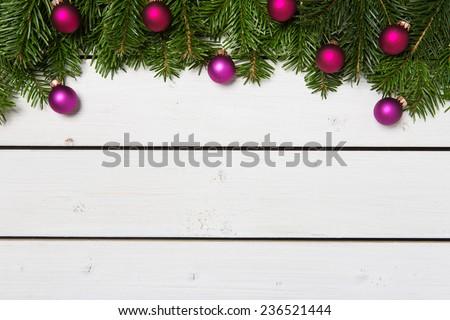Christmas decoration on white wooden background - stock photo
