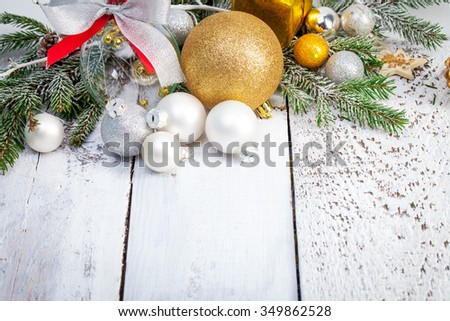 Christmas decoration on white wooden background - stock photo