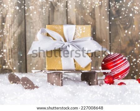 Christmas decoration on wood plant, snow  - stock photo