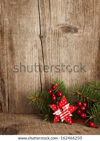 Christmas decoration on wooden plank. - stock photo