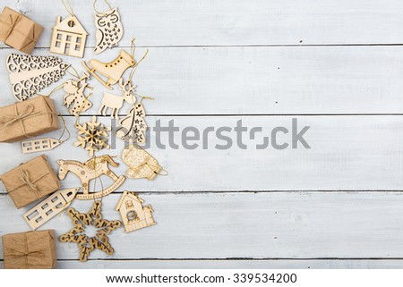 christmas decoration on wooden table - gift boxes, snowflakes, angel, deer, house, tree etc. - stock photo