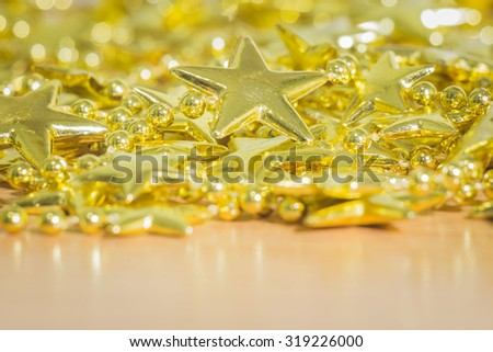 Christmas decoration on wooden table over lights background, selective focus, rustic style  - stock photo