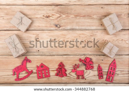 christmas decoration on wooden table - Xmas tree, houses, angel, deer, gifts - stock photo