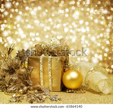 Christmas Decoration over Glittering Golden Background