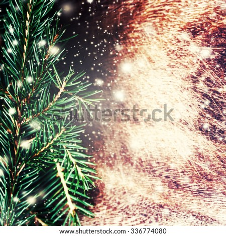 Christmas decoration over grunge background - Christmas fir tree on dark wooden board with Falling Snow. Card or invitation. - stock photo
